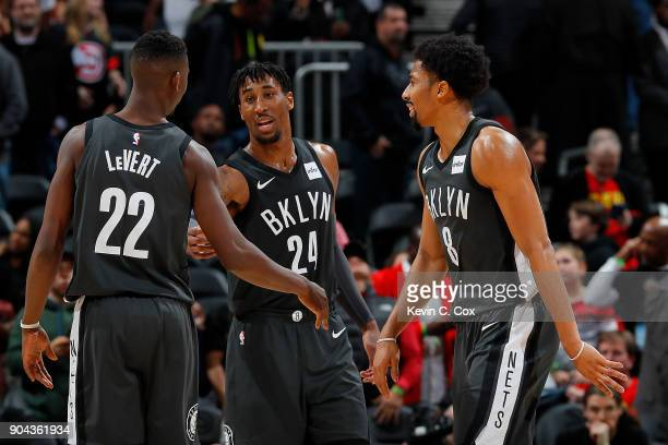 Spencer Dinwiddie Rondae HollisJefferson and Caris LeVert of the Brooklyn Nets react after their 110105 win over the Atlanta Hawks at Philips Arena...