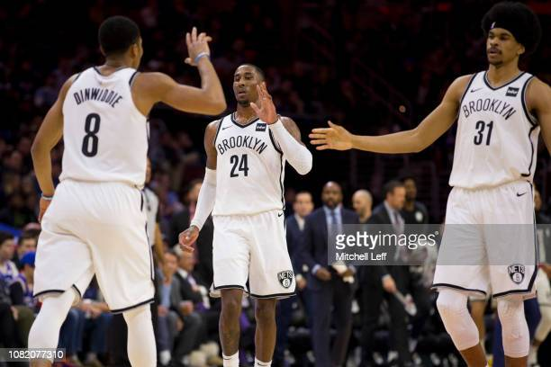 Spencer Dinwiddie Rondae HollisJefferson and Jarrett Allen of the Brooklyn Nets celebrate against the Philadelphia 76ers at the Wells Fargo Center on...