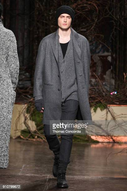 Spencer Draeger walks the runway wearing John Varvatos Fall/Winter 2018 with makeup by Chika Chan for MakeUp Pro and Hair by Yannik D'Is for...