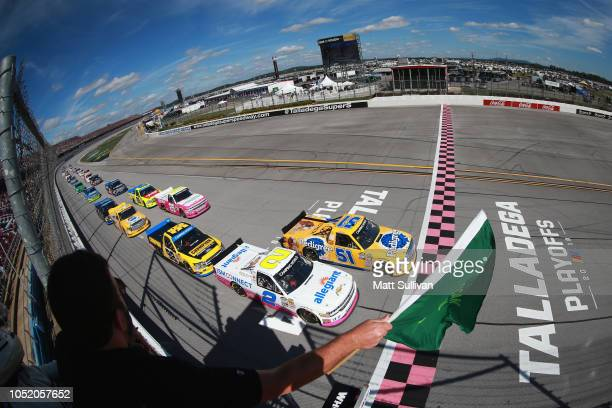 Spencer Gallagher driver of the Allegiant Chevrolet and David Gilliland driver of the Pedigree Toyota lead the field to the green flag to start the...