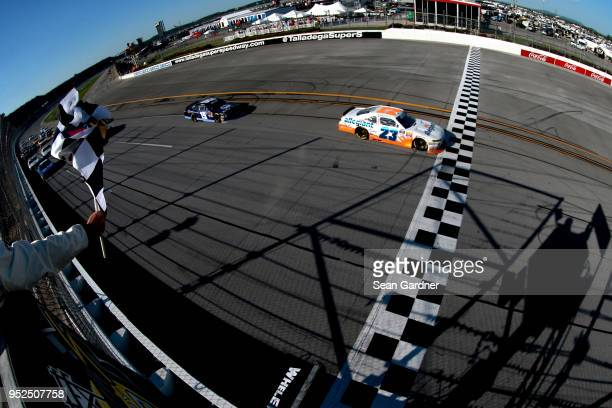 Spencer Gallagher driver of the Allegiant Chevrolet takes the checkered flag to win the NASCAR Xfinity Series Sparks Energy 300 at Talladega...