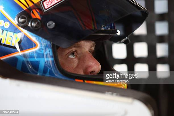Spencer Gallagher driver of the Chapel of the Flowers Chevrolet sits in his truck during practice for the NASCAR Camping World Truck Series Pocono...