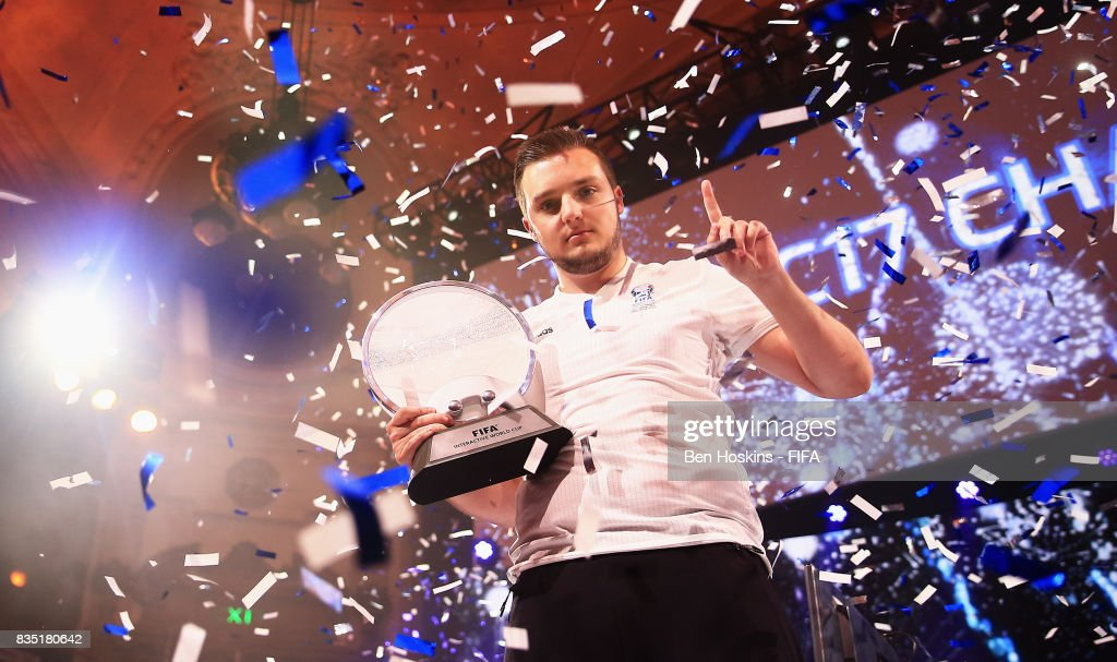 Spencer 'Gorilla' Ealing of England celebrates with the trophy after his victory in the final against Kai 'Deto' Wollin of Germany during day three of the FIFA Interactive World Cup 2017 Grand Final at Central Hall Westminster on August 18, 2017 in London, England.
