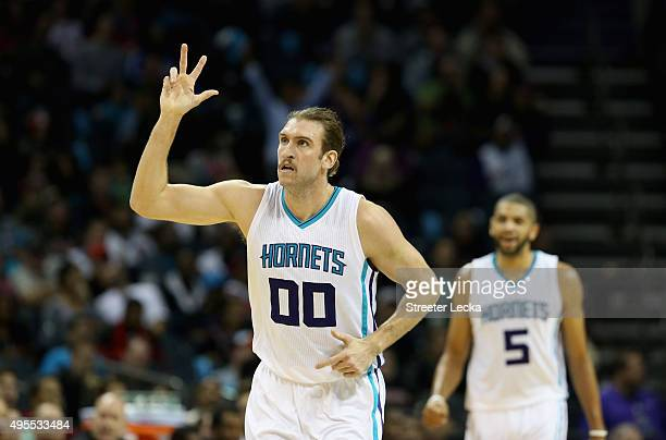 Spencer Hawes of the Charlotte Hornets reacts after hitting a shot against the Chicago Bulls during their game at Time Warner Cable Arena on November...