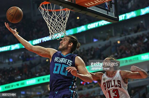 Spencer Hawes of the Charlotte Hornets rebounds in front of Joakim Noah of the Chicago Bulls at the United Center on December 5 2015 in Chicago...