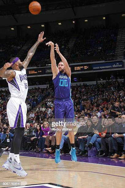 Spencer Hawes of the Charlotte Hornets shoots against DeMarcus Cousins of the Sacramento Kings on January 25 2016 at Sleep Train Arena in Sacramento...