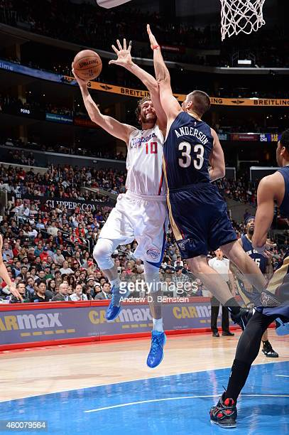 Spencer Hawes of the Los Angeles Clippers goes up for a shot against the New Orleans Pelicans on December 6 2014 in Los Angeles California NOTE TO...