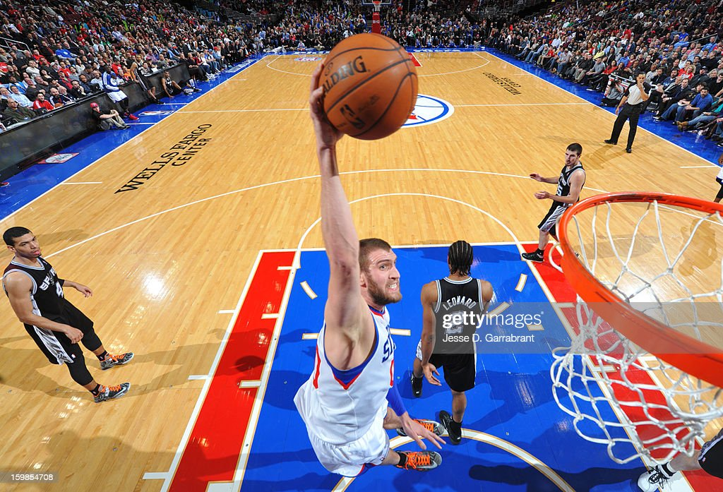 Spencer Hawes #00 of the Philadelphia 76ers dunks against the San Antonio Spurs during the game at the Wells Fargo Center on January 21, 2013 in Philadelphia, Pennsylvania.
