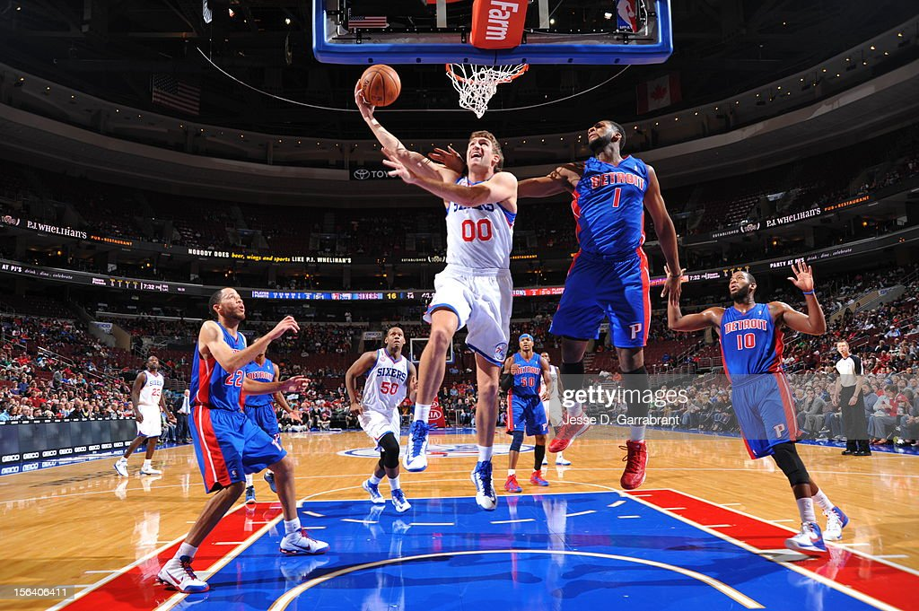 Spencer Hawes #00 of the Philadelphia 76ers goes to the basket against Andre Drummond #1 of the Detroit Pistons during the game between Detroit Pistons and the Philadelphia 76ers at the Wells Fargo Center on November 14, 2012 in Philadelphia, Pennsylvania.