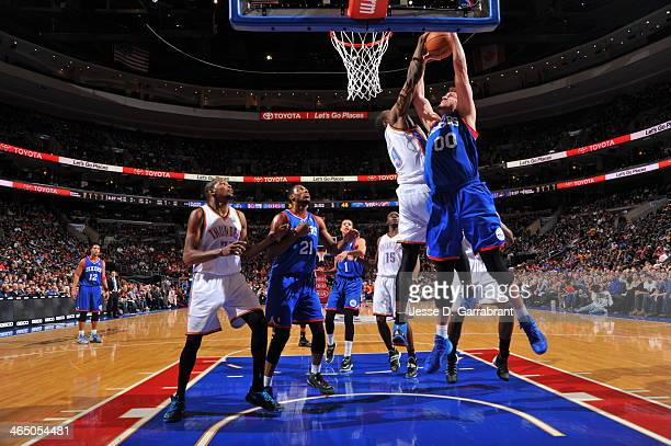 Spencer Hawes of the Philadelphia 76ers going up for a dunk during a game against the Oklahoma City Thunder at the Wells Fargo Center on January 25...