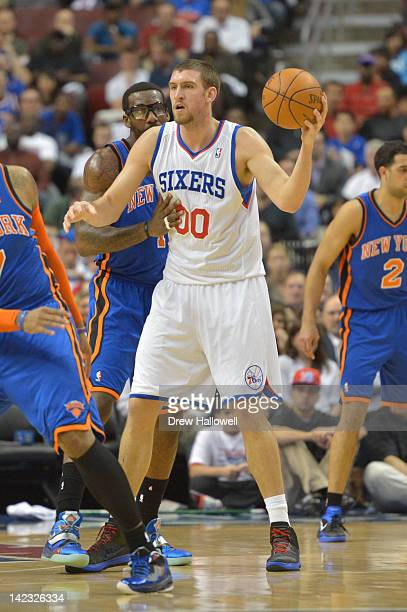 Spencer Hawes of the Philadelphia 76ers looks to pass during the game against the New York Knicks at the Wells Fargo Center on March 21 2012 in...
