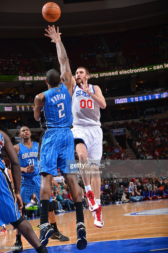 Spencer Hawes #00 of the Philadelphia 76ers puts up a shot against the Orlando Magic at the Wells Fargo Center on February 4, 2013 in Philadelphia, Pennsylvania.