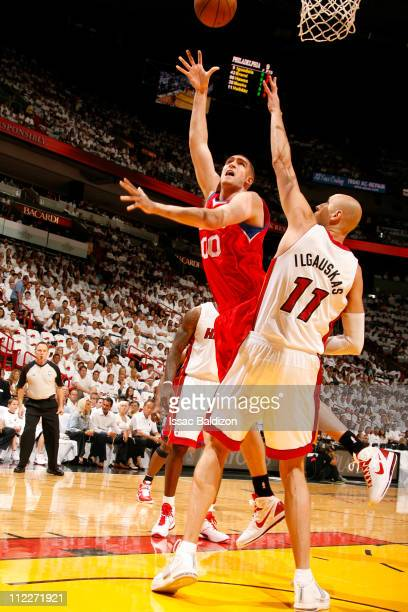 Spencer Hawes of the Philadelphia 76ers shoots against Zydrunas Ilgauskas of the Miami Heat in Game One of the Eastern Conference Quarterfinals in...