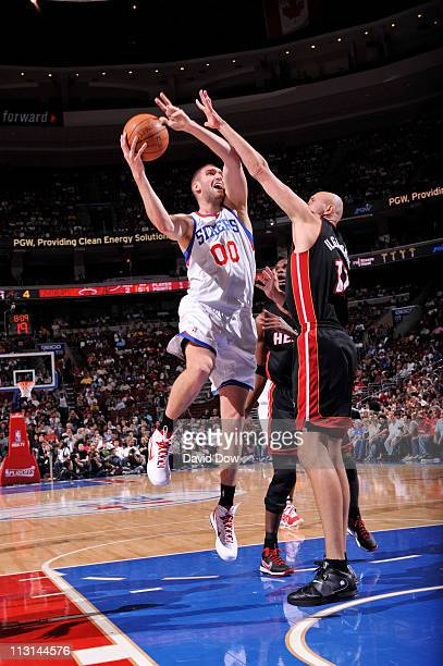 Spencer Hawes of the Philadelphia 76ers shoots against Zydrunas Ilgauskas of the Miami Heat in Game Four of the Eastern Conference Quarterfinals in...