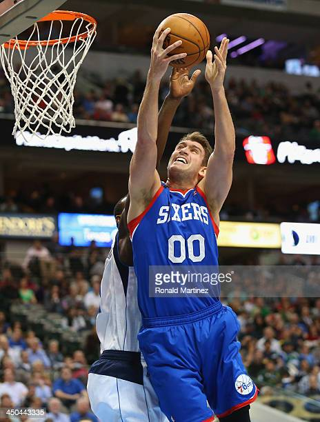 Spencer Hawes of the Philadelphia 76ers takes a shot against the Dallas Mavericks at American Airlines Center on November 18 2013 in Dallas Texas...