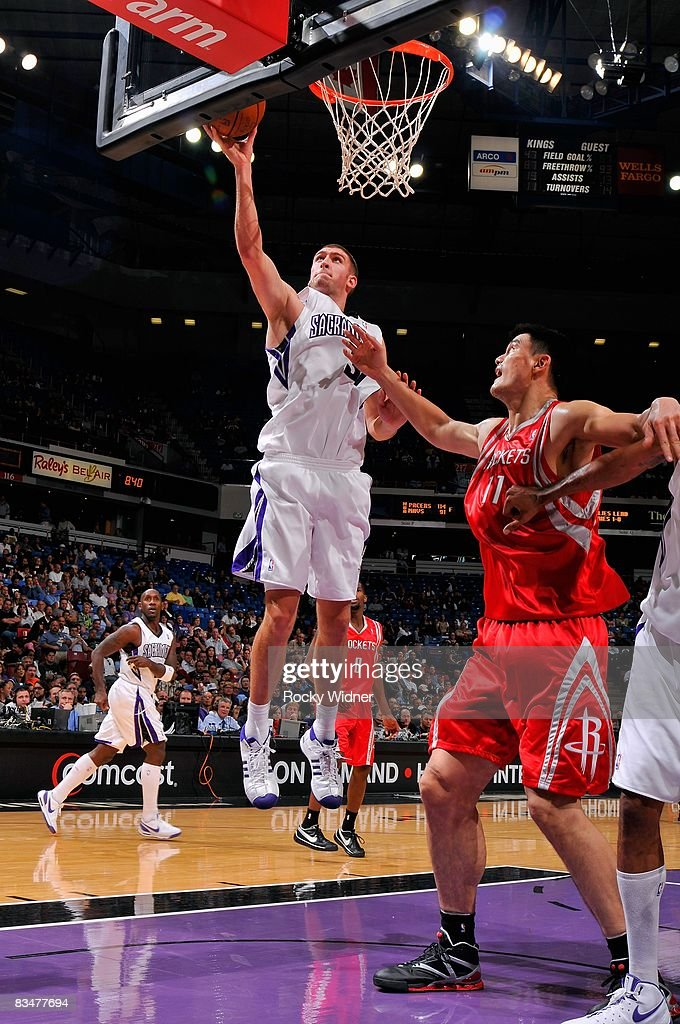 Spencer Hawes of the Sacramento Kings goes to the basket