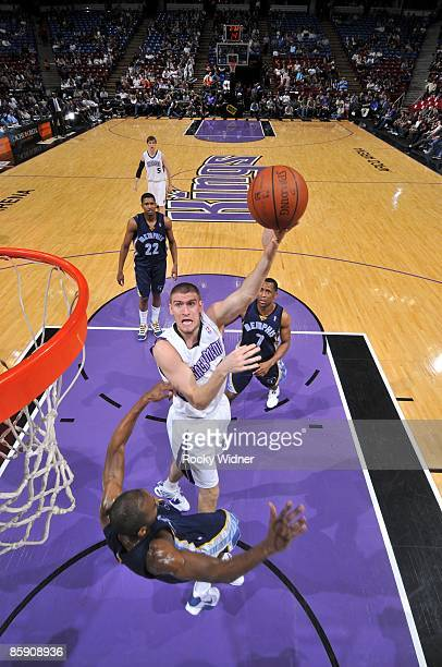 Spencer Hawes of the Sacramento Kings shoots over Quinton Ross of the Memphis Grizzlies during the game at Arco Arena on March 27 2009 in Sacramento...