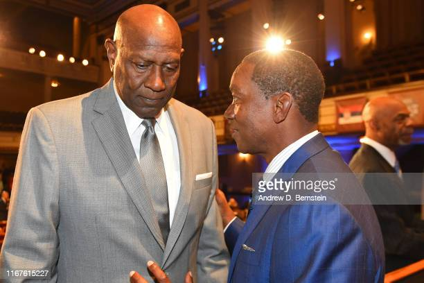 Spencer Haywood and Isiah Thomas talk during the 2019 Basketball Hall of Fame Enshrinement Ceremony on September 6, 2019 at Symphony Hall in...