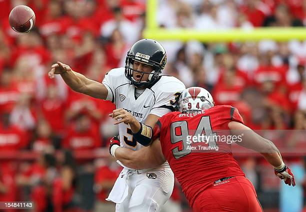 Spencer Keith of the Kent State Golden Flashes is tackled by Scott Vallone of the Rutgers Scarlet Knights at High Point Solutions Stadium on October...