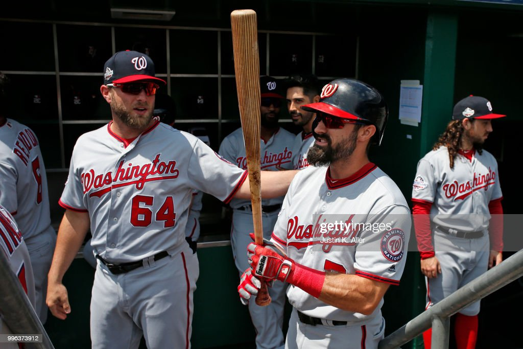 Spencer Kieboom #64 of the Washington Nationals talks to Adam Eaton #2 before the game against the Pittsburgh Pirates at PNC Park on July 11, 2018 in Pittsburgh, Pennsylvania.
