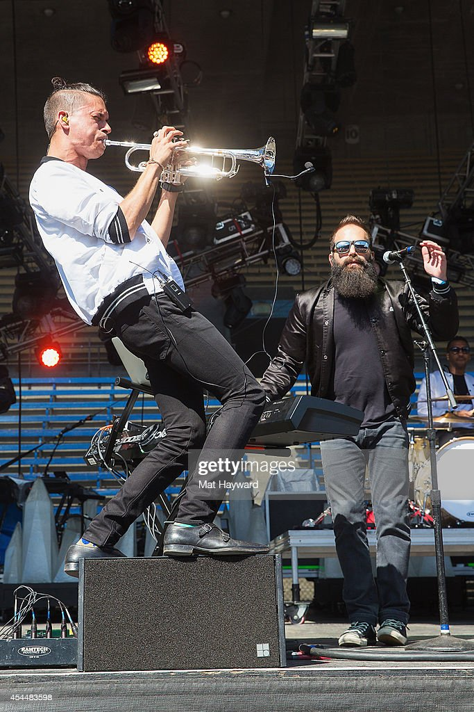 Spencer Ludwig (L) and Sebu Simonian of Capital Cities perform on the main stage during the Bumbershoot Music and Arts Festival on September 1, 2014 in Seattle, Washington.