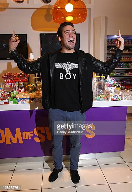 Spencer Matthews attends a photocall to open the UK's Largest sweet shop Kingdom of Sweets at Lakeside Shopping Centre on November 26 2012 in...