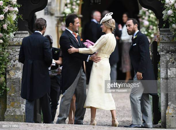 Spencer Matthews brother of James Matthews greets Donna Air as she attends the wedding of Pippa Middleton and James Matthews at St Mark's Church on...