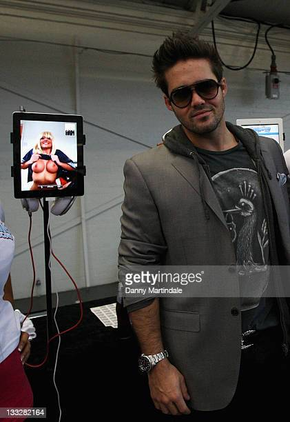 Spencer Matthews is seen watching topless girls on web cam at Erotica 2011 at Olympia on November 18 2011 in London England