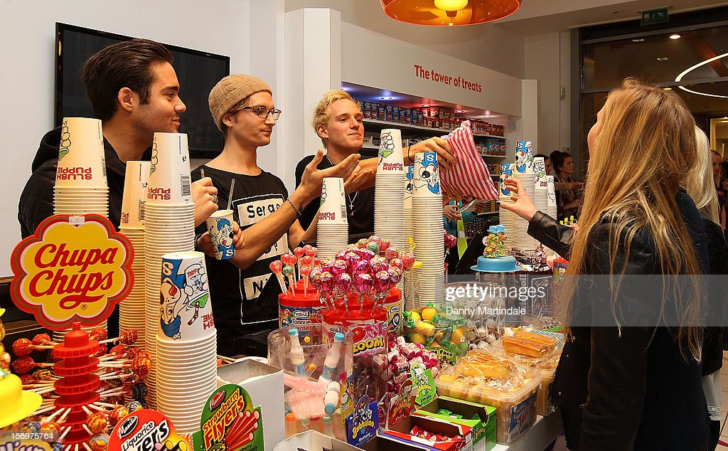 Spencer Matthews, Jamie Laing and Oliver Proudlock serve costermers at a photocall to open the UK's Largest sweet shop - Kingdom of Sweets at Lakeside Shopping Centre on November 26, 2012 in Thurrock, England.