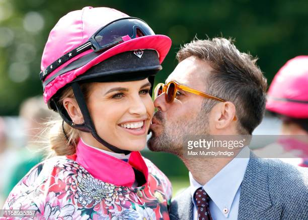 Spencer Matthews kisses wife Vogue Williams before she takes part in the 'Magnolia Cup' charity ladies race on 'Ladies Day' of the Qatar Goodwood...