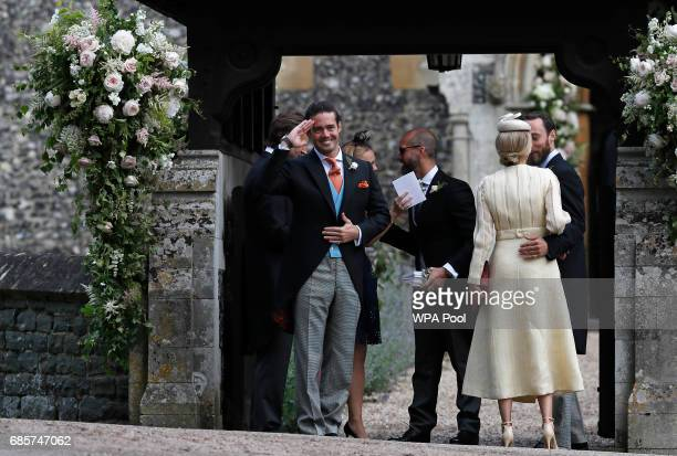 Spencer Matthews left gestures as he stands with James Middleton right and Donna Air at the entrance of St Mark's Church ahead of the wedding of...