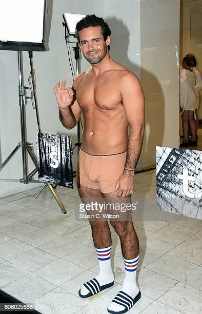 Spencer Matthews poses in a shop window to launch Lyst's augmented reality dressing experience on September 16 2016 in London England