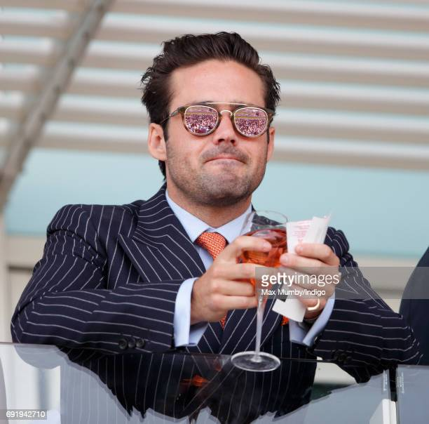 Spencer Matthews watches the racing as he attends Derby Day during the Investec Derby Festival at Epsom Racecourse on June 3 2017 in Epsom England