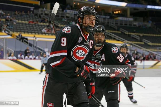 Spencer Meier of the St. Cloud State Huskies reacts after scoring a goal in the first period during the Division I Men's Ice Hockey Semifinals game...