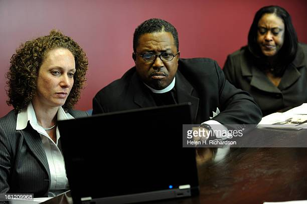 Spencer middle and his wife Gail Booker right sit with attorney Mari Newman left and watch the recently released video tape The Bookers drove over 9...