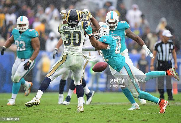 Spencer Paysinger of the Miami Dolphins breaks up the pass to Todd Gurley of the Los Angeles Rams during the third quarter of the game at Los Angeles...