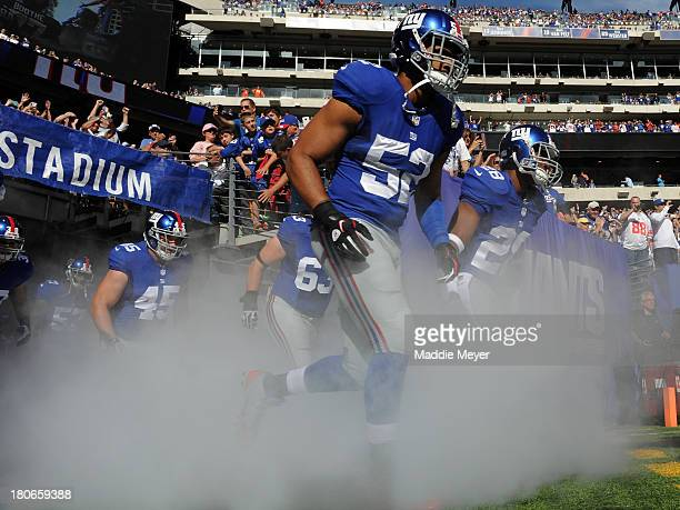 Spencer Paysinger of the New York Giants takes the field before the game against the Denver Broncos at MetLife Stadium on September 15 2013 in East...