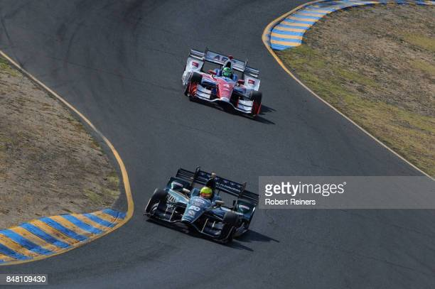 Spencer Pigot driver of the Fuzzy's Vodka Chevrolet leads Conor Daly driver of the ABC Supply Chevrolet during qualifying for the GoPro Grand Prix of...