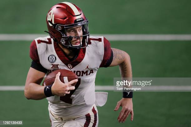 Spencer Rattler of the Oklahoma Sooners carries the ball to score a touchdown against the Iowa State Cyclones in the second quarter of the 2020 Dr...