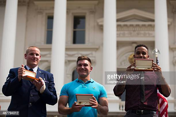 Spencer Stone Alek Skarlatos and Anthony Sadler display keys to the city of Sacramento given by Mayor Kevin Johnson during a parade to honor their...