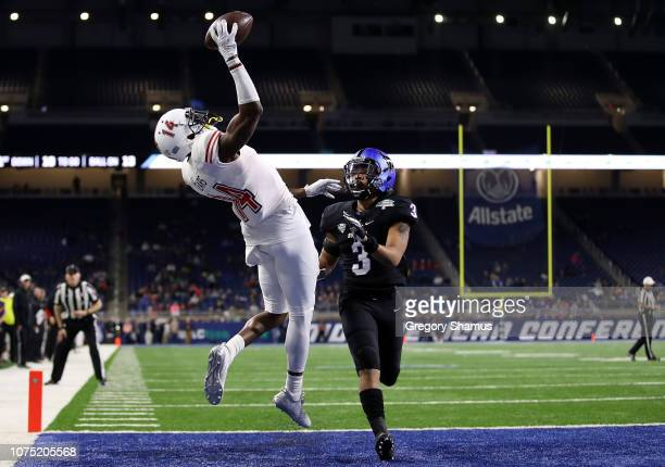 Spencer Tears of the Northern Illinois Huskies catches a first half touchdown next to Aapri Washington of the Buffalo Bulls during the MAC...