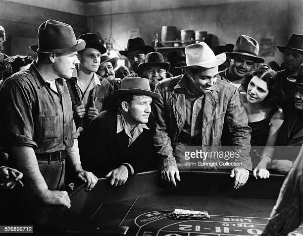 Spencer Tracy as Jonathan Sand Clark Gable as John McMasters playing a game of Craps in the 1940 film Boom Town