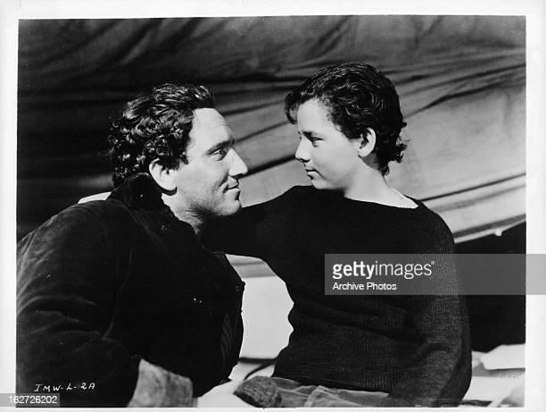 Spencer Tracy smiling at young Freddie Bartholomew in a scene from the film 'Captains Courageous' 1937