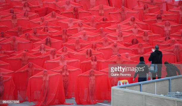 Spencer Tunick takes photographs as part of Spencer Tunick's nude art installation Return of the Nude on July 9 2018 in Melbourne Australia Tunick...