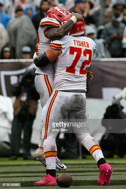 Spencer Ware of the Kansas City Chiefs celebrates with Eric Fisher after a twoyard touchdown against the Oakland Raiders during their NFL game at...