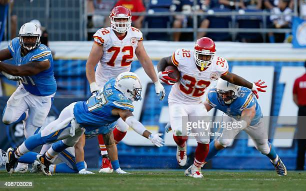 Spencer Ware of the Kansas City Chiefs eludes Jimmy Wilson of the San Diego Chargers and Kyle Emanuel of the San Diego Chargers during a game at...