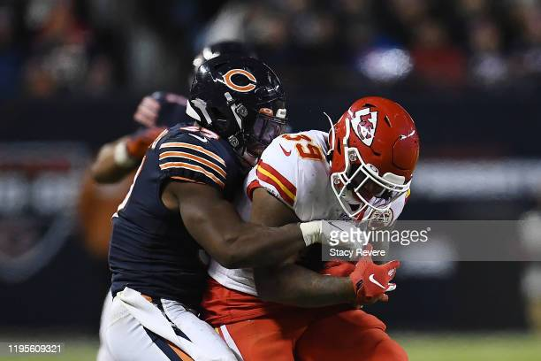 Spencer Ware of the Kansas City Chiefs is brought down by Nick Williams of the Chicago Bears during a game at Soldier Field on December 22 2019 in...