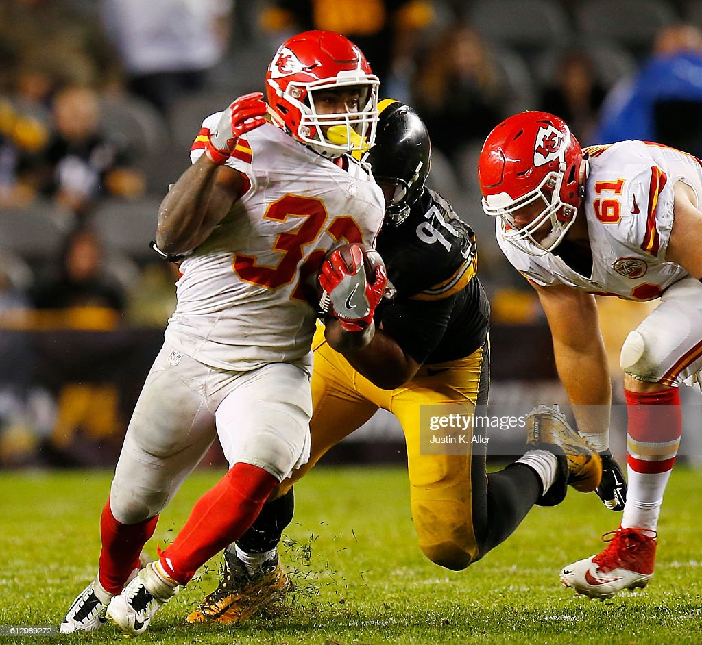 Spencer Ware #32 of the Kansas City Chiefs is tackled by Cameron Heyward #97 of the Pittsburgh Steelers in the second half during the game at Heinz Field on October 2, 2016 in Pittsburgh, Pennsylvania.