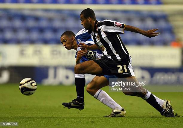 Spencer WeirDaley of Notts County and Lewis Montrose of Wigan Athletic in action during the Carling Cup second round match between Wigan Athletic and...