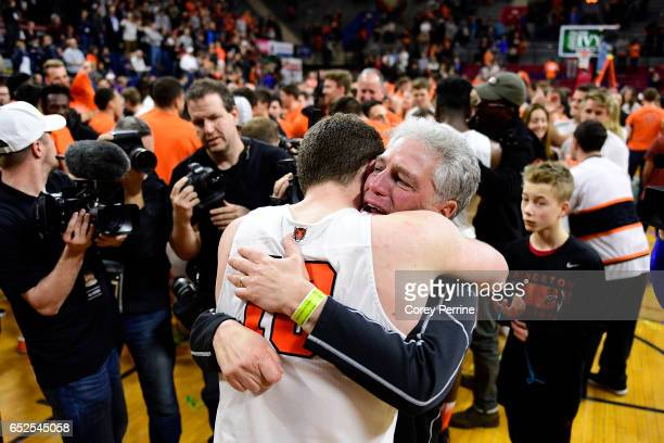 Spencer Weisz of the Princeton Tigers is hugged by his teary-eyed father, Andrew Weisz, expressing how proud he is during the second half of the Ivy...